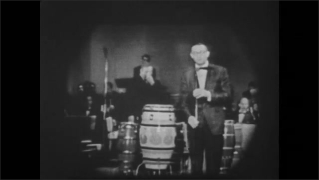 1950s: UNITED STATES: Man turns on television. The Dave Alan Show title. Man speaks to audience