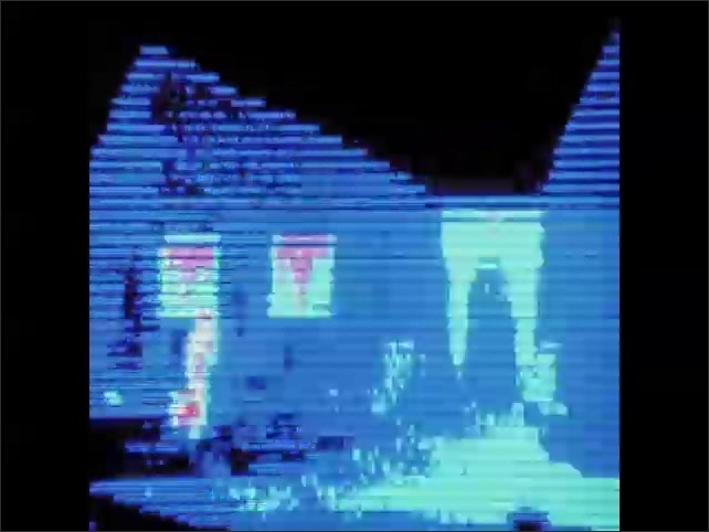 1970s: Boy walks dog from door of contemporary house. Heat sensitive camera image of  boy and dog leaving home. Heat sensitive image of shutter opening on window of home.
