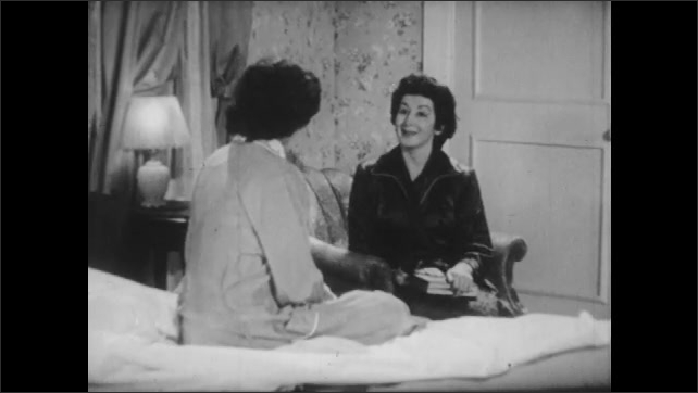 1950s: UNITED STATES: mother enters daughters bedroom. Lady sits by bed. Daughter talks to mother.