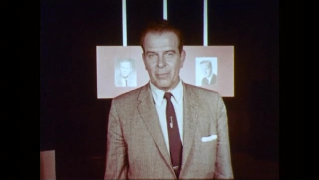 1960s: UNITED STATES: presenter in suit talks directly to camera. Man walks across studio set. Two men talk at desk