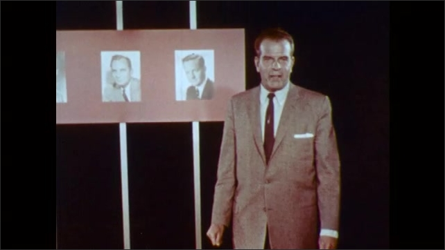1960s: UNITED STATES: presenter in suit talks to camera. Man gestures with hands. Photos of men on wall. Pictures disappear.