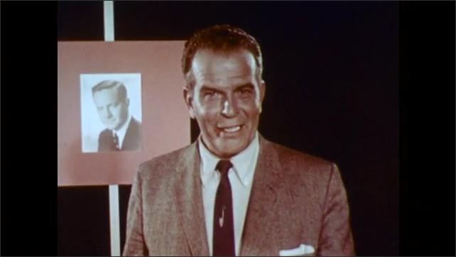 1960s: UNITED STATES: man speaks directly to camera. Presenter talks to studio camera