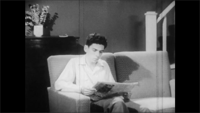 1950s: Newspaper sports section. Teen boy sits on couch, reads newspaper, looks up, walks to door, looks down at newspaper.
