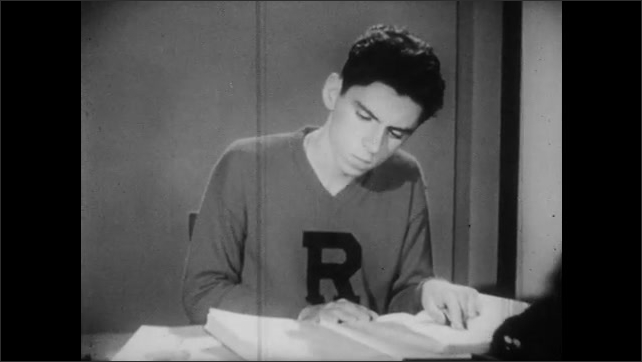 1950s: Wooden boards travel along conveyor belt, train travels above. Boy sits at desk, reads book. Explanatory text on how to develop interest.