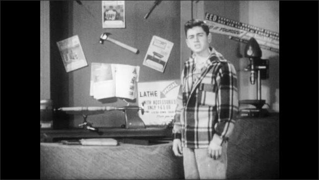 1950s: Teenaged boy inspects wood lathe. Teenaged boy speaks and looks dubious.