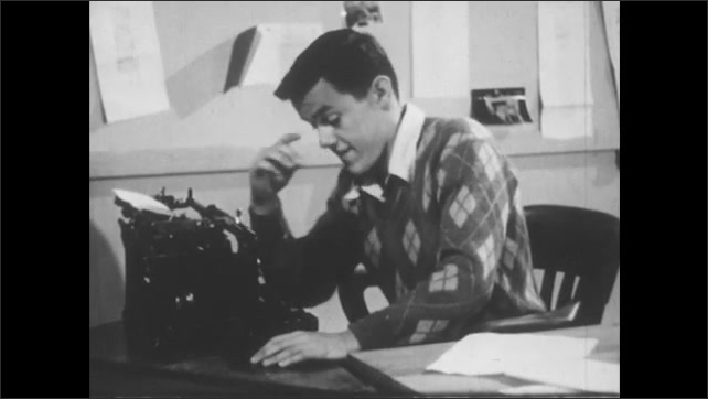 1950s: Young man types on typewriter at desk, then pulls paper out and stacks it with others.