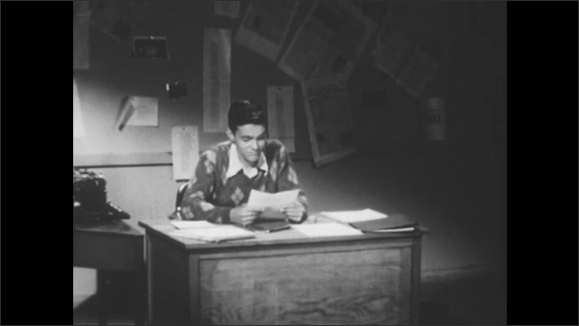 """1950s: Hand writes the words """"false analogies"""" next to crossed out, typed words. Young man sits at desk reading pieces of paper. Woman sits in living room talking."""