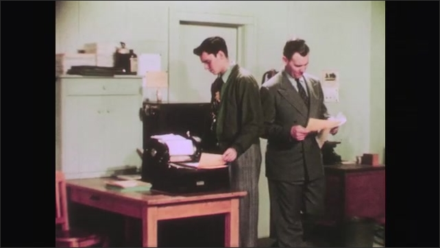 1950s: Twin continues making copies on duplicating machine. Boss walks in to shipping department, critiques copy quality and looks concerned.