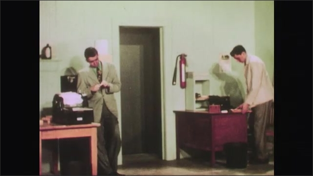 1950s: Lazy twin looks in mirror and cleans nails. Lazy twin leaves work and conscientious twin continues prepping the shipping department for the next day. Interviewer and applicant continue talking.