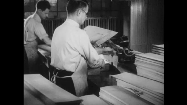 1950s: UNITED STATES: view across soil. Metal production. Man drinks cup of coffee. Milk in factory. Man supervises work