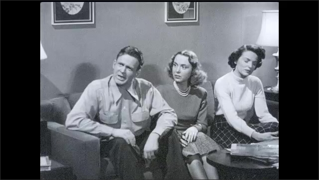 1950s: Man is on television talking. Man goes up to tv in living room, turns it off, starts talking to man and two women. Woman leaves room. Man, woman on couch talk. Woman enters room with tray.