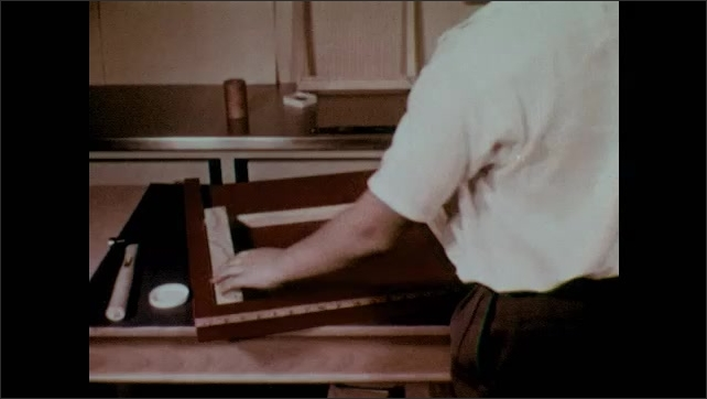 1950s: Boy hammers in a nail in the corner of the wooden loom frame. Boy rotates the frame and then nails the next corner. Boy holds up the finished loom frame.