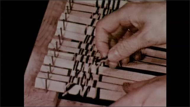 1950s: Yarn woven under and over bamboo strips in place of warp. Weaver removes the bamboo weaving from the loom and holds it up.