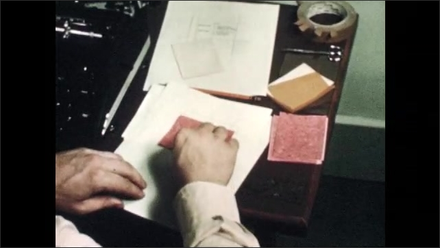 1940s: Diagram of slide.  Man folds carbon paper and tapes in place.