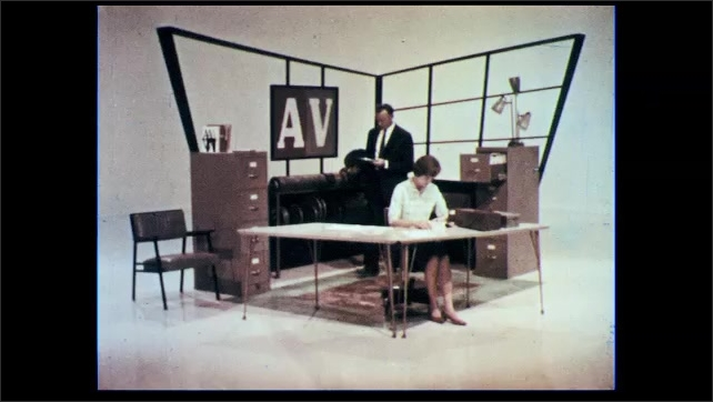 1960s: Woman talking, turns on projector. Man and woman in office, zoom in on woman, word appears on screen.