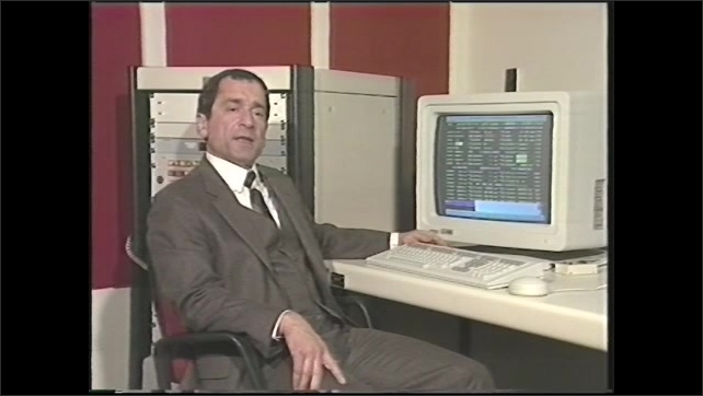 1990s: Ron Felice, NASA/Goddard Space Flight Center, sits at computer and points to code on monitor screen.