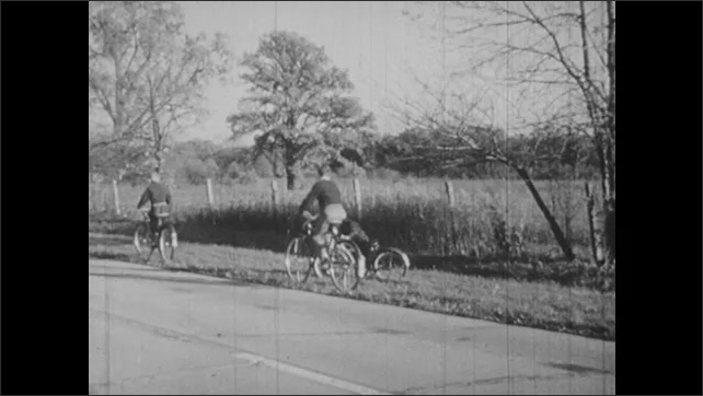 1950s: car and truck drive alongside each other, car drives head-on towards car, man puts hand in front of face, tilts, black screen, children on bicycles, boys carry coffin, sad man holds hat