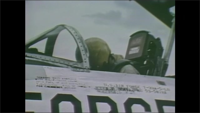 1980s: Lights come on.  Man sits in small capsule.  Man adjusts dials.  Pilot closes cockpit of jet.