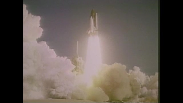 1980s: Rocket launch.  Space shuttle takes off.  Astronauts float in space.