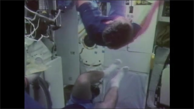 1980s: Astronauts move through cabin by grabbing onto the walls.  People float and pull on handles.