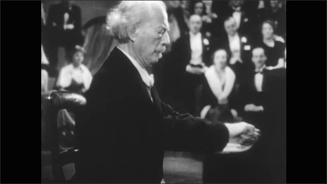 1940s: Man plays piano.  Audience watches.