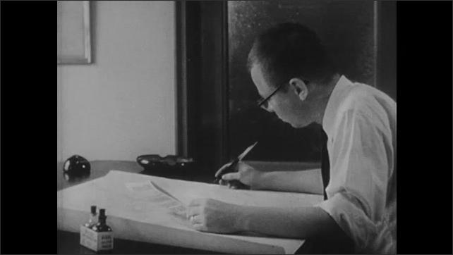 1950s: Man draws weather map.