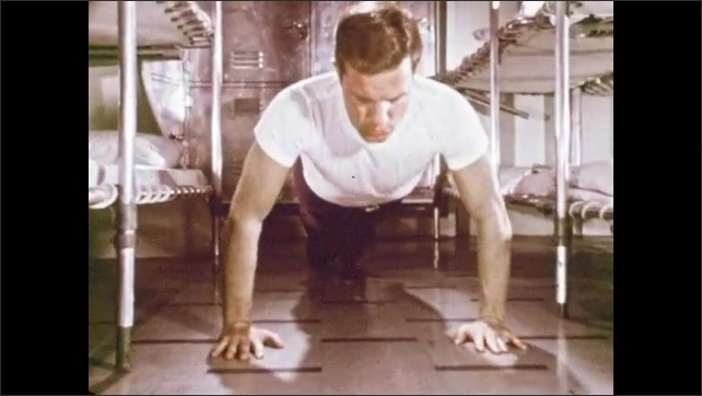 1970s: Man feels around other man's neck. Man does push-ups. Men move down cafeteria line, gather food onto trays.