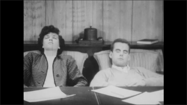 1940s: Man and woman at table. Man leans back in chair, asleep. Woman leans back in chair, sleeps.