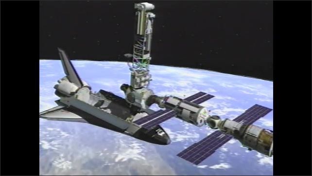 1990s: Space module docks with ISS. Space shuttle extends material near space station. ISS extends solar sails. Engineers work on space laboratory component at warehouse.