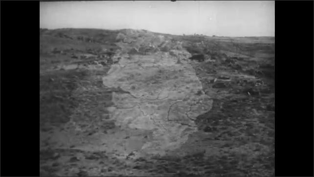 1940s: MEDITERRANEAN: map shows farmland on plateau. View across wasteland.
