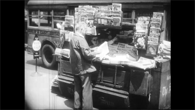 1940s: People congregate outside of city church. Newspapers in foreign languages. Man buys newspaper from stand. Men and women talk outside trade union office.
