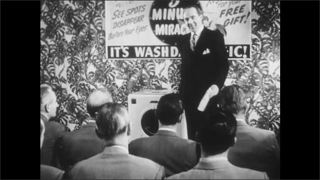 1950s: Man asks speaker a question.
