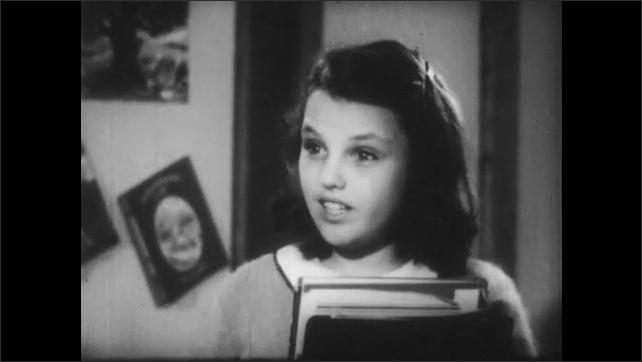 1940s: A boy talks. A girl talks. Another boy talks.