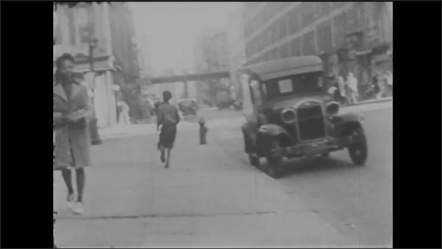 1940s: Children carry cardboard down street and run. Children hit each other with stockings full of flour. Boy with fake beard waves and talks to friends on sidewalk.