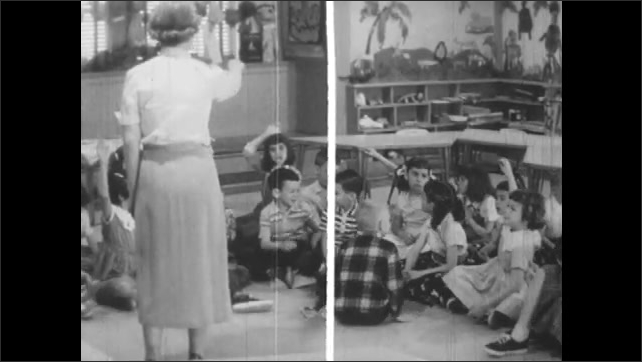 1950s: Woman stands in front of class, calls on kids raising hands. Girl points, zoom out to classroom.