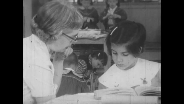 1950s: Students paint and play with blocks.  Teacher sits and talks with students.