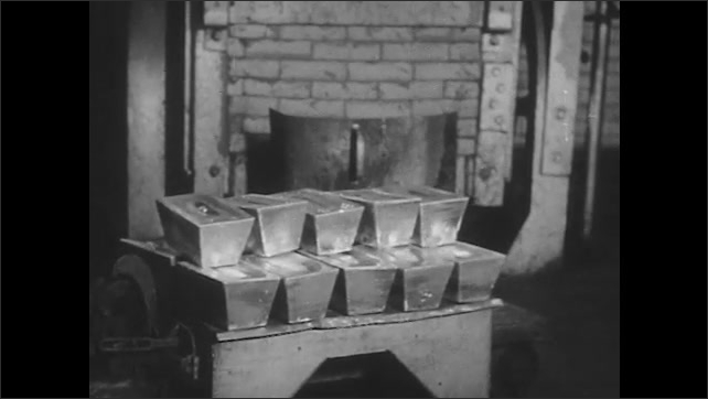 1950s: Smelting bucket pours molten metal into mold. Man lowers gold ingots into bucket using tongs. Hand truck pulls bars of silver. Molten copper pours into molds. Copper bars fall from machine.