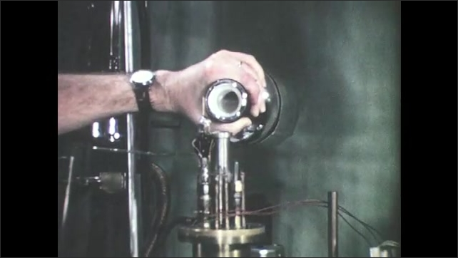 1960s: Balls spin around. Medicine vial. Man pours liquid into chemistry equipment. Jars filled with liquid. Machine draws lines on chart.
