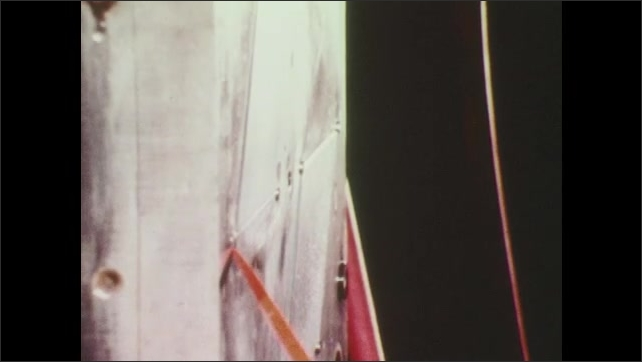 1970s: Rust on industrial machine. Industrial mold. Metal prod is used along wall of mold. Hand adjusts bolt on mold. Small, red objects are dumped into machine.