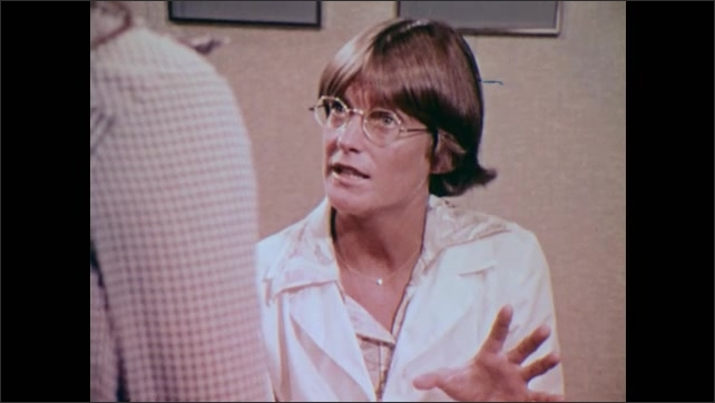 1980s: UNITED STATES: lady in clinic talks to patient. Container for diaphragm.