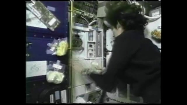 "1990s: Astronauts prepare food and eat in space.  Text reads ""FAJITA.""  Woman climbs into sleep pod."