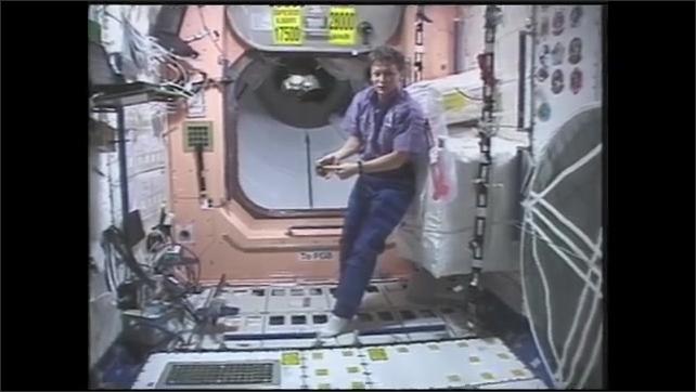 1990s: Astronaut plays with yo-yo in zero gravity on space station. Woman points to yo-yo. Hands point to computer display on yo-yo. Woman plays with yo-yo in zero gravity. Girl jumps rope.