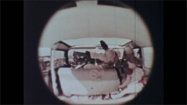 1960s: Close-up details of crashed test cars. Crash test dummies fly around the interior of a crashing car.