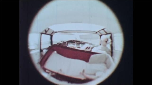 1960s: Interior of crash test dummies in car. Baby in bassinet is thrown around on impact. Toddler girl dummy is thrown to the front seat violently.