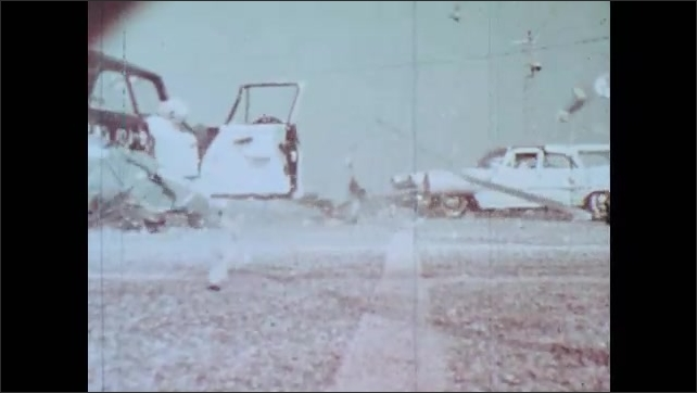 1960s: Close-up of test cars crashing. Glass shatters and falls and door flies open. Crash test dummy is ejected out of car.