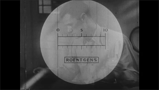 1940s: UNITED STATES: reading and scale in Roentgens on dosimeter. Scale set to zero on dosimeter. Man sets up pocket chamber.