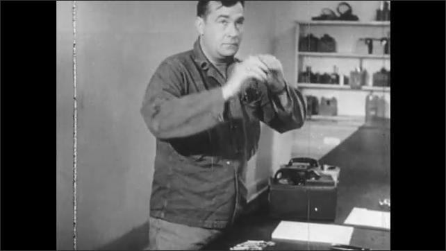 1940s: UNITED STATES: man calibrates gamma survey meters.