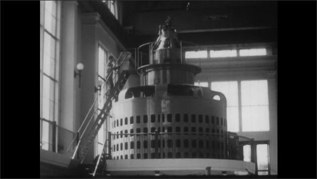1940s: Large turbine inside hydro-electric dam. Hydro-electric dam. Man climbs up equipment inside dam. Truck pulls up to power station. Power station. Girl brushes hair.