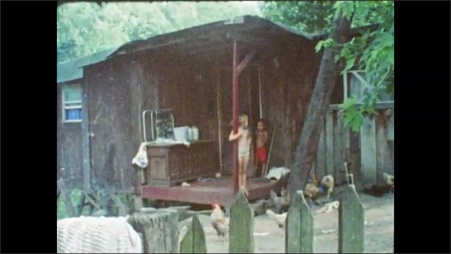 1980s: man sits and smokes cigarette in messy bedroom. guy, woman, boys and girls stand at house. family gathers under porch. sign reads it's Hell without money. kids play on low income housing.