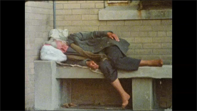 1980s: man hugs and kisses woman missing teeth. lady without shoes sleeps on outdoor bench with garbage bag as pillow. guy sits near woman. child with bare chest leans on post. girl rests on chair.
